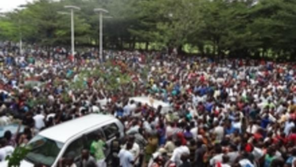 Burundians gather outside the headquarters of RPA  to welcome the release of Bob Rugurika
